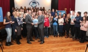 Chargé d'Affaires Paul Horowitz with a group of 65 high school students